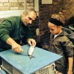 Veaseys: Paul showing a little friend how to fillet fish